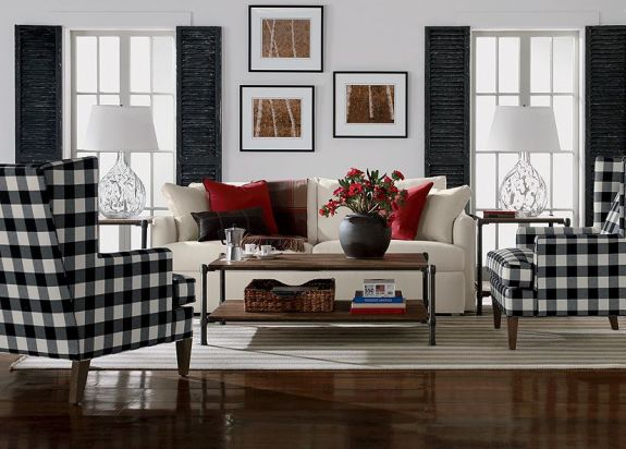 Black shabby chic shutters and checked fabric on the wing chairs add casual comfort to this traditional living room. (Photo: Ethan Allen)