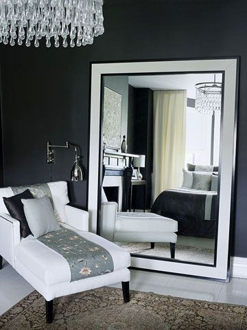Love the look of this bedroom sitting area, though I don't think I could live with the dark gray walls.