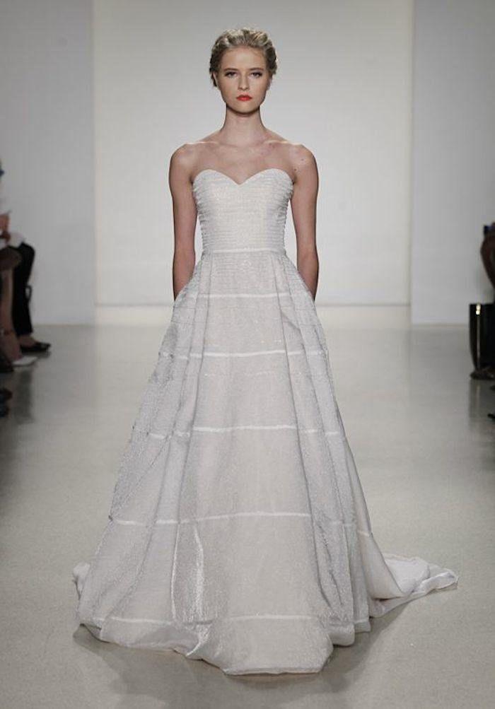 Simple stunning - we love this classic sweetheart neckline wedding dress! Dress Designer: Kelly Faetanini