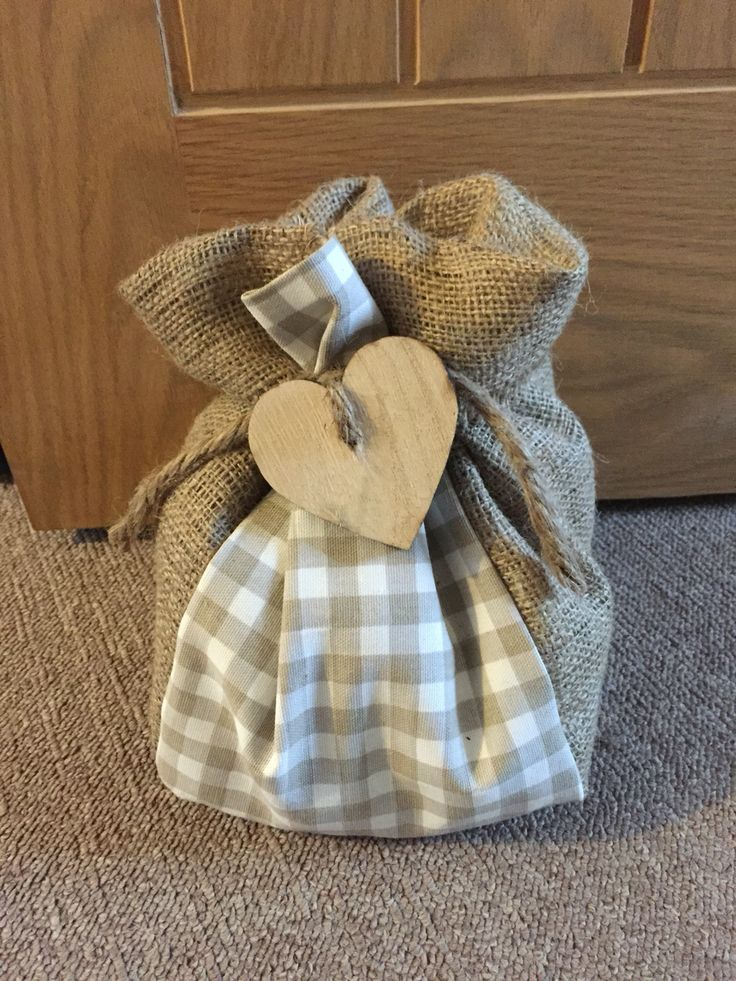 Handmade rustic door stop Using Clarke and Clarke fabric with hessian
