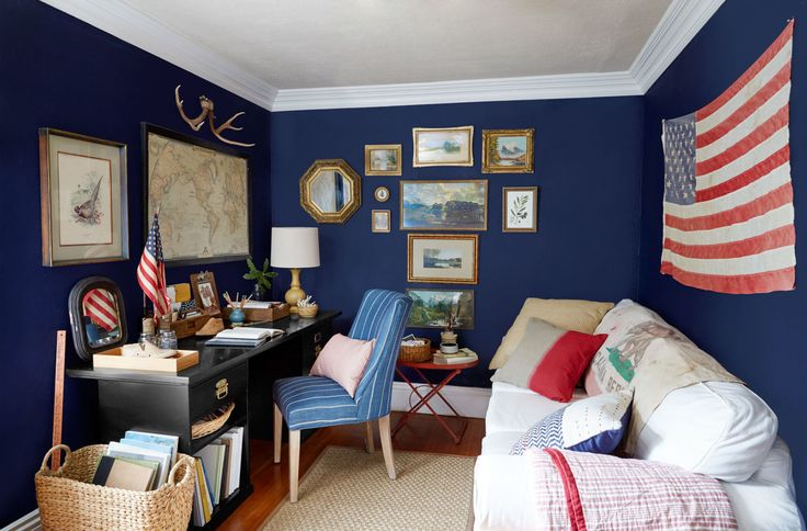 A vibrant navy paint job helps the 8'-by-10' room feel cozy, not claustrophobic. Thoughtfully chosen, truly personal finds also help the space feel collected, not cluttered. Those antlers, for example: The couple stumbled across them on a hike, then Janet secured them together with twine.