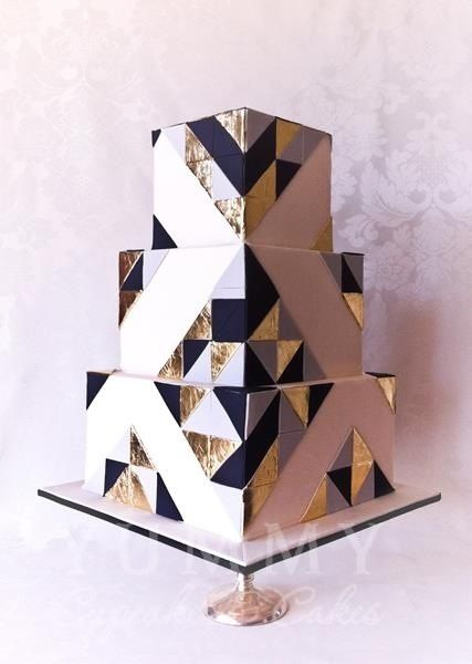 """For a """"Classic"""" wedding try a """"Modern"""" wedding cake! This black, white, silver, and gold cake is geometric inspiration for your own big day. We love that it's mod and timeless all in one!"""