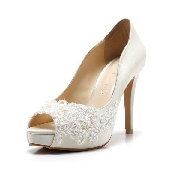 These ivory white wedding heels you see are handcrafted from high quality satin, embroidered lace, fabric, genuine cow leather and other man made