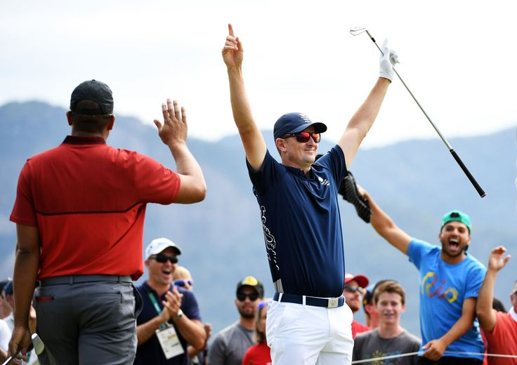 Smelling like a Rose:    Justin Rose of Great Britain, center, celebrates with Jhonattan Vegas of Venezuela after hitting a hole-in-one on the fourth hole during the first round at the Olympic Golf Course on Aug. 11.