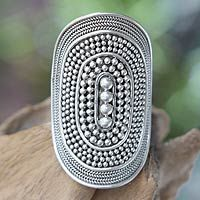 Sterling silver ring, 'Galaxy Queen'. Utilizing the traditional Balinese jewelry technique of granulated silver, artisan Komang Wijayana creates this original ring design. Concentric ovals culminate in larger silver beads at the ring's center, evoking the galaxy in which we live. $74.99