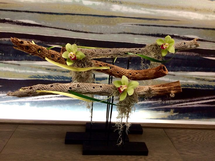 Decaydence...cactus woods sculpturally composing with cymbidium orchids, Spanish moss and pandanus leaves