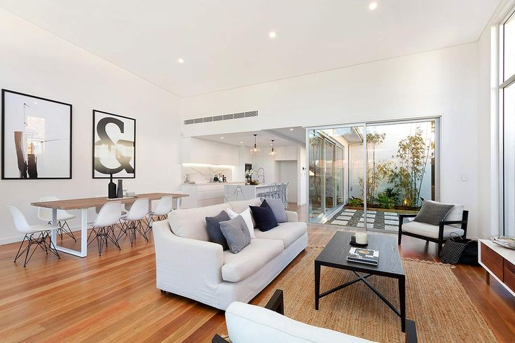 Contemporary Dual Occupancy Sydney   pavilion design   Modern home   architecture   Timber facade   cedar cladding   arches   timber hood   oriental inspired   open plan   ceaserstone kitchen   modern kitchen   courtyard   loungerrom   side by side   modern townhouse   exterior facade   highlight windows   timber floors  