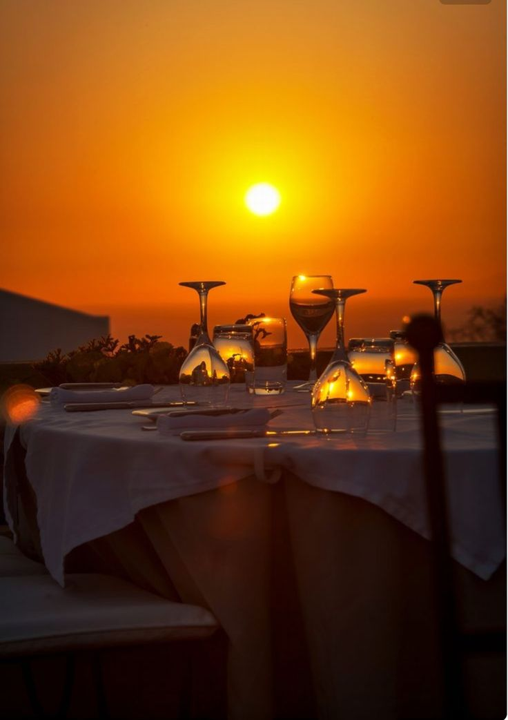 Dinner for two, at Oia Mansion's terrace, with unobstructed caldera sunset views. Oia village, Santorini island, Greece -  www.oiamansion.com