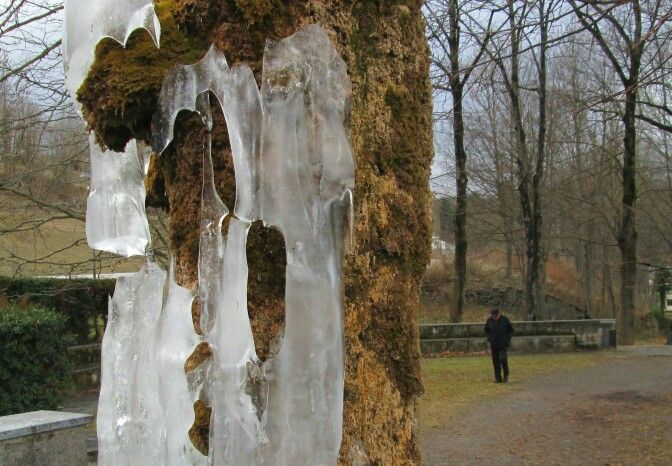 spain, camprodon - ice on mossy fountain pillar