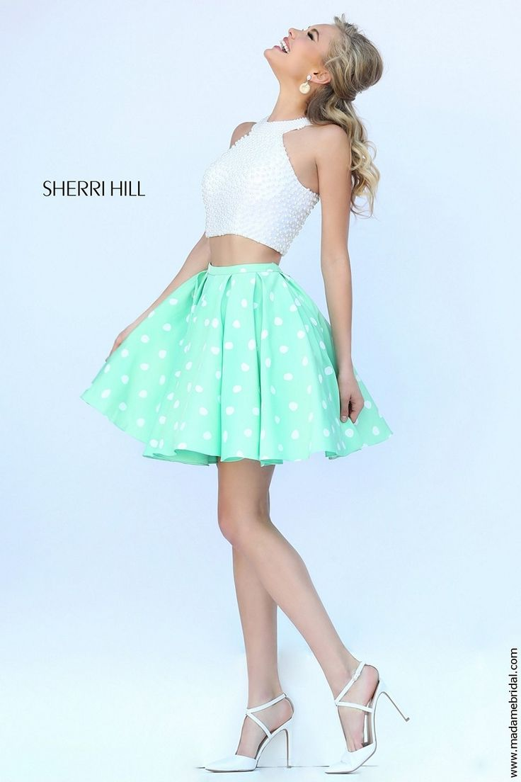 New for 2015...Have fun with the fluttering two-piece ensemble of Sherri Hill 32244 short dress. Faux pearls festoon the crop top, drawing emphasis into the jewel neckline set amid the cut-in sleeves. Leaving a bare midriff, the polka dot skirt takes off at the natural waist, cascading onto the cocktail length with a fabulous swirl. Twin pockets are sewn along the side seams. Available in Ivory-Mint, Ivory-Blue and Ivory-Pink.