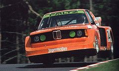 Harald Grohs flying high in his Jägermeister BMW 320 at the Eifelrennen 1977