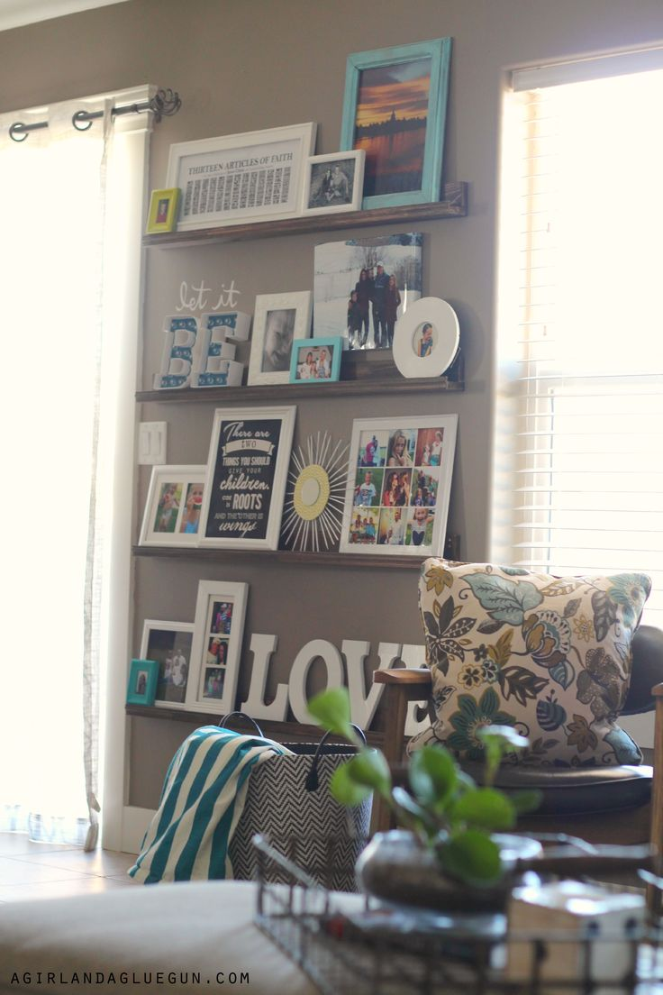 Decorating with pictures---easy diy picture ledges! - A girl and a glue gun