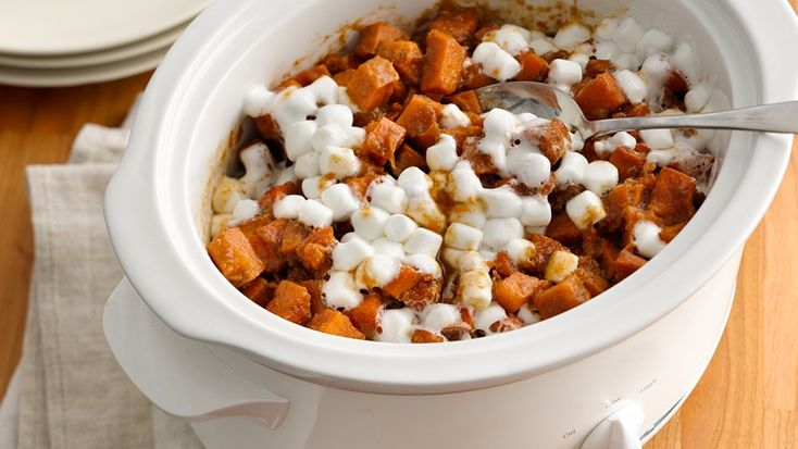 Slow-Cooker Sweet Potato Casserole - Want that marshmallow-topped sweet potato flavor without taking up precious oven space? Just make it in the slow cooker instead!