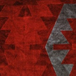 Upholstery velvet in shades of crimson and gray. Pattern is Navaho-esque and would look striking in any room.