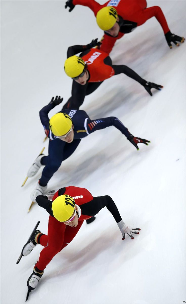 China's Yu Jiyang, front, leads during a men's 1,000-meter quarter final race at the World Cup short track speed skating championship in Dresden, Germany.