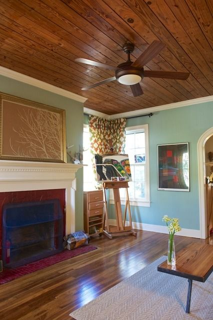 I love this ceiling! And I like how the ceiling fan kind of blends in. It would be fun to do a planked ceiling in the living room but I don't know about resale value.