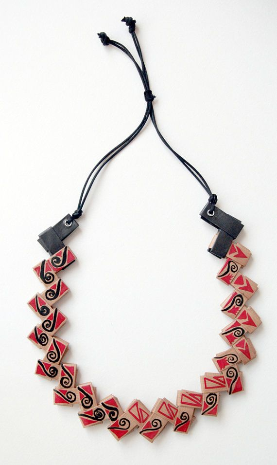 unique recycled paper origami necklace with spirals red & black. I handcrafted this necklace with the origami technique, by folding the paper and fitting the various elements together. I decorated it with acrylics colors. Its length is adjustable, you can adapt it to your liking. It has a first quality cord whose characteristics are the smoothness and brightness of the colors. I used finishing products to protect it: withstands water but is NOT waterproof.