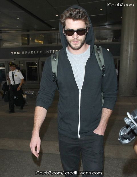Liam Hemsworth  arrives at Los Angeles International Airport (LAX) http://icelebz.com/events/liam_hemsworth_arrives_at_los_angeles_international_airport_lax_/photo1.html