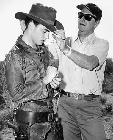 John Wayne giving Ricky Nelson tips on how to 'set' his hat during shooting of Rio Bravo (1959)