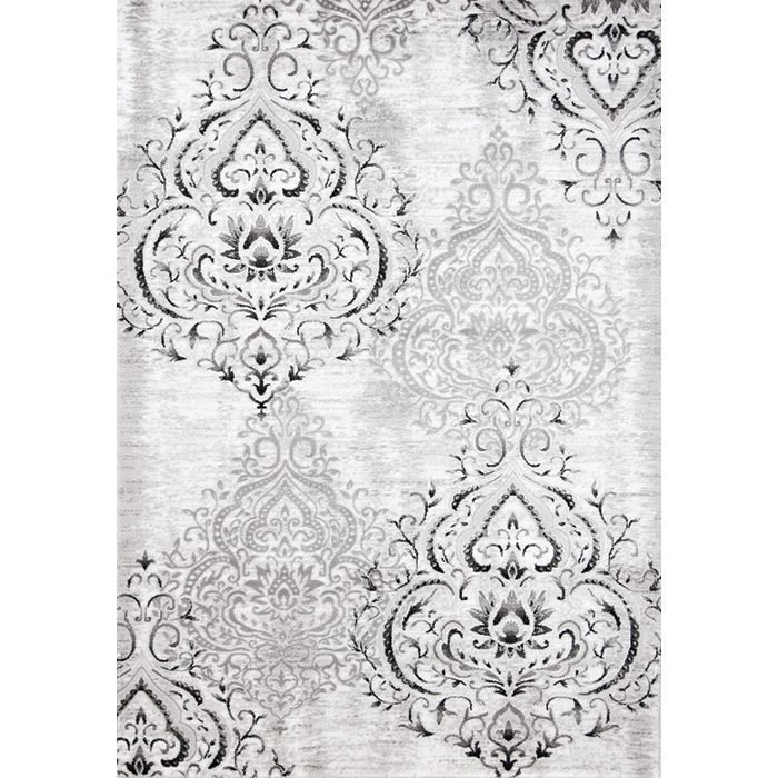 Complete your home with this machine-made rug made of heat set polypropylene for a soft, cushiony surface. This rectangular rug features a graphic design in white. Your interior decor will love this b