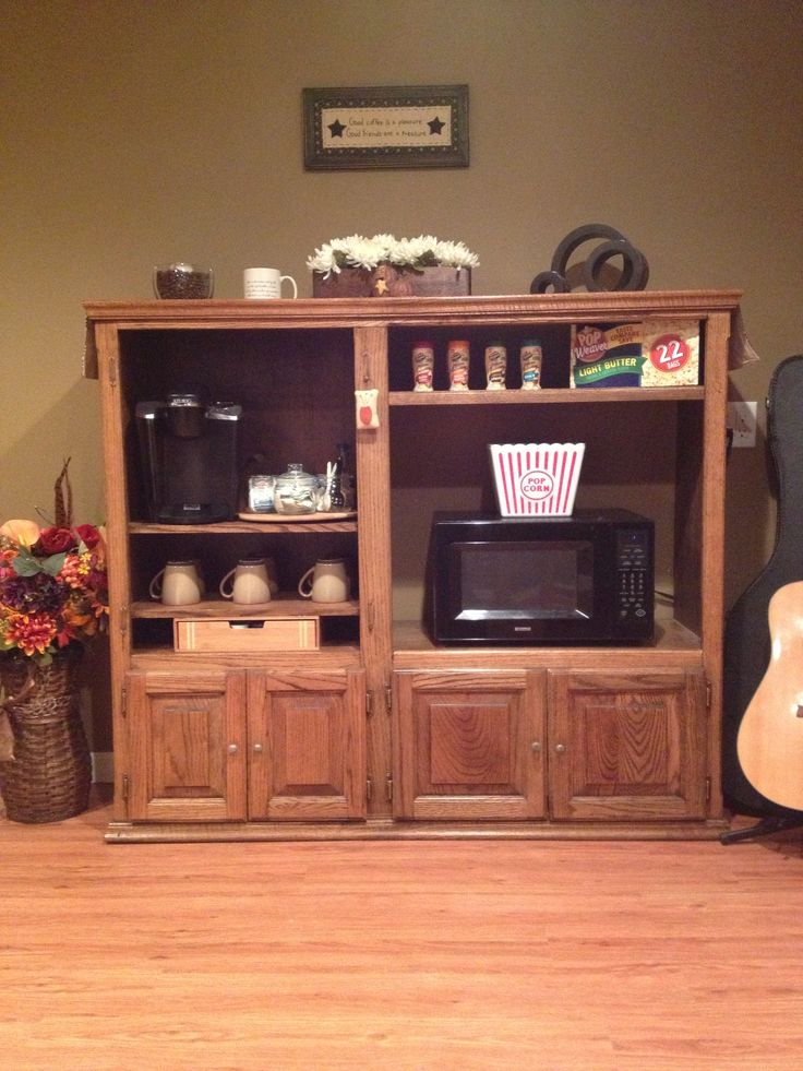 I repurposed an old entertainment center into my very own popcorn and coffee bar!