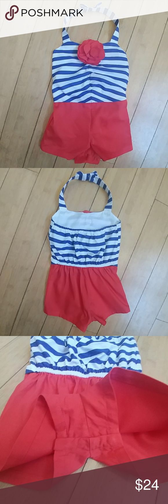 Janie and Jack red, white, & blue stylish romper Like new, used 2 times. Nautical romper with blue, & white striped top, top off with a red flower in center. Red shorts; . Halter neck with cute bow accent, & one button fasten. Bottom of romper has 4 snaps to change the baby easier. Ready for the beach, add sunglasses & flip flops. Janie and Jack One Pieces