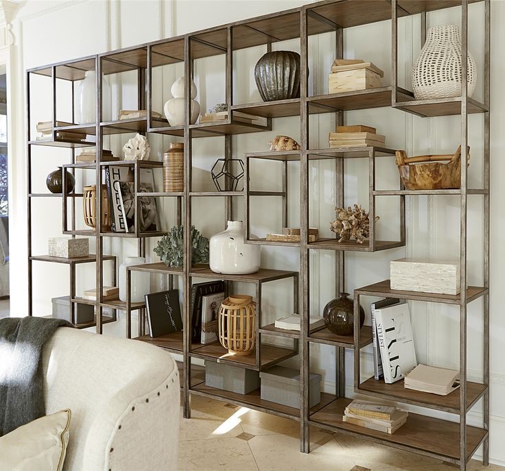 Living room etagere bookcases (http://www.zinhome.com/french-modern-industrial-wood-metal-bookcase-etagere/)