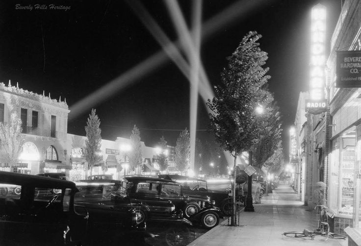 I wish I knew more about this photo than I do. This is Beverly Drive, in Beverly Hills, in 1929 on a night when I'm guessing something big was going on—at least big enough to warrant four searchlights.