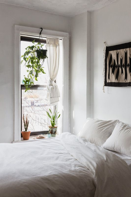 small all-white bedroom with windowsill