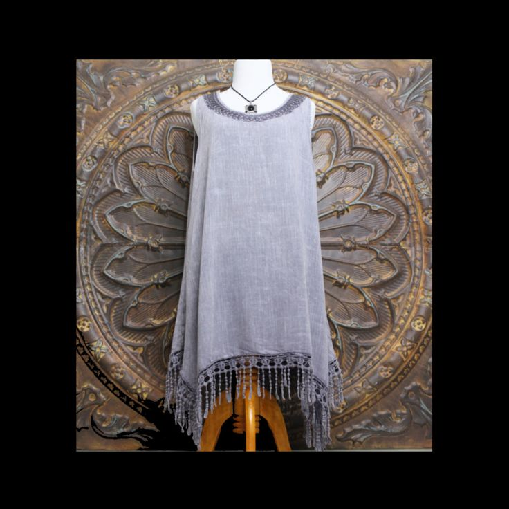 """Bailey - Lavender Sleeveless Embroidered Tunic Top with Shark Bite Fringed Hemline  Our """"Bailey"""" sleeveless tunic tunic is made from linen feel fabric with shark bite fringed hem. Super chic and comfortable you can wear as a dress or top. Embroidered neckline and fringed hem gives this dress a flirtatious flair.  Available in the following sizes:   Small Medium  Large"""