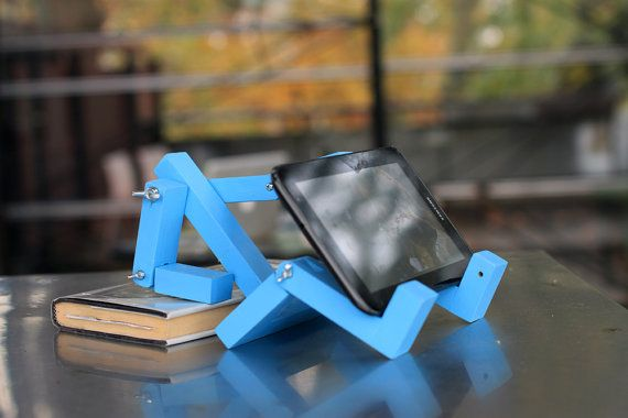 This product is an awesome accessory for your iPod, iPad or any phone or tablet that you have. Easily change color and positions to suit your style and personality. Sturdy wood material. Fun, quirky conversation piece that will stand out in your home or office.