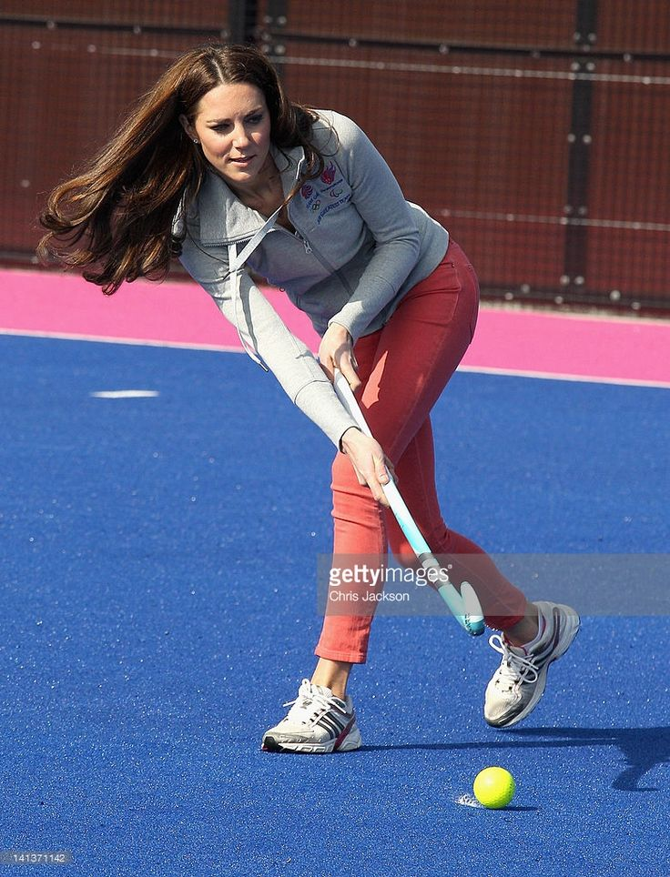 Catherine, Duchess of Cambridge plays hockey with the GB hockey teams at the Riverside Arena in the Olympic Park on March 15, 2012 in London, England. The Duchess of Cambridge viewed the Olympic park as well as meeting members of the men's and women's GB Hockey teams.  (Photo by Chris Jackson - WPA Pool /Getty Images)
