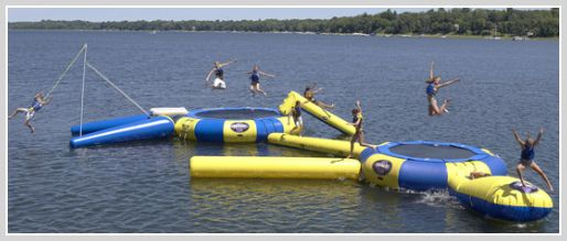 Fun in the sun with the best water trampoline. The difference between water trampolines and water bouncers explained. Come join the party, if you can jump!