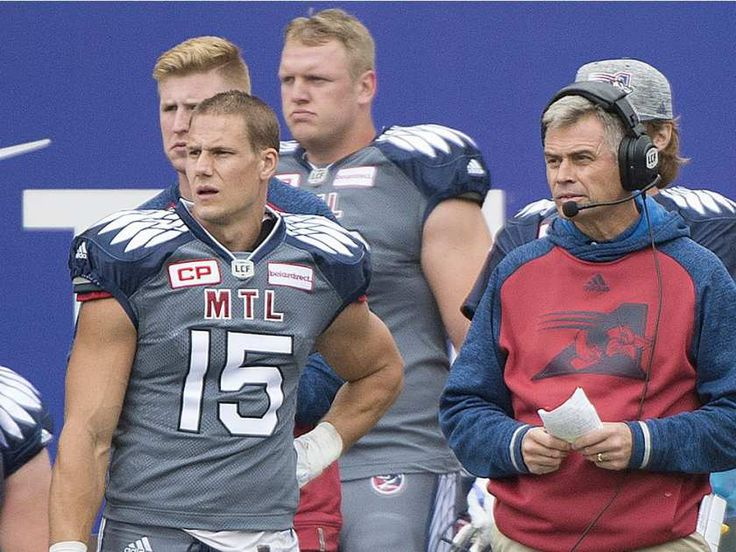 Montreal Alouettes head coach Jacques Chapdelaine, right, and player Samuel Giguere look on from the sideline during first half CFL football action between the Alouettes and the Toronto Argonauts in Montreal, Sunday, October 2, 2016.