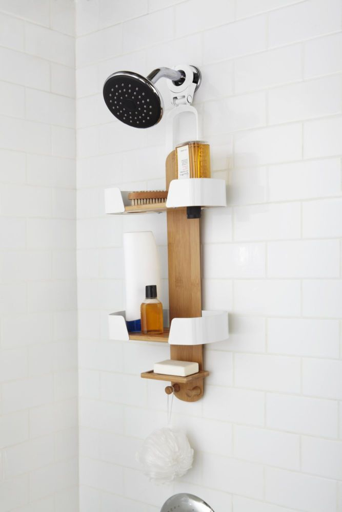 <p>The Decker shower caddy by Umbra adds functionality and compliments a contemporary lifestyle. Made of bamboo and metal, decker featured two large draining shelves which can accommodate large shampoo and conditioner bottles, one soap dish, and two bamboo hooks for all of your shower supplies. The universal mounting hook does not require any tools, which allows for ease of set up. Decker measures 5-1/4-Inch by 10-Inch by 28-Inch . Designed by Anthony Keeler for Umbra- original, modern…