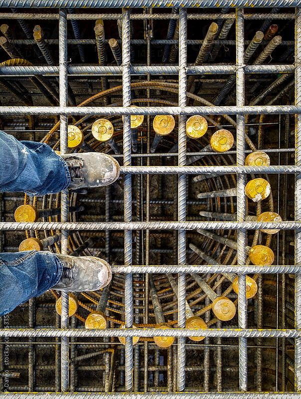 Civil Construction Worker Boots On Concrete Bridge Reinforcing Steel Cage by JP Danko for Stocksy United