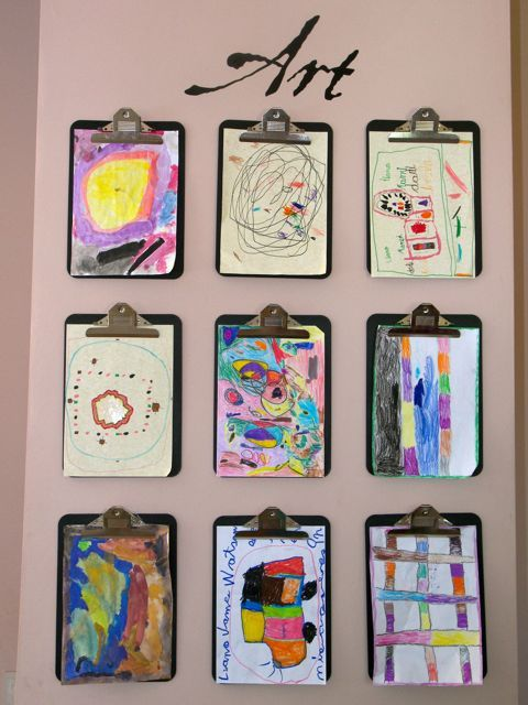 """Art wall where """"the children choose where to put new artwork so that we don't hurt their feelings when updating the art wall."""""""