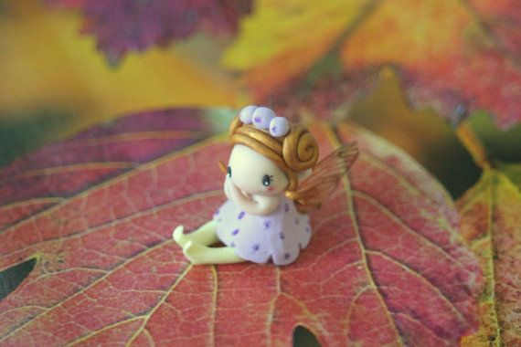 Hey, I found this really awesome Etsy listing at https://www.etsy.com/listing/247136142/miniature-fairy-figurine   Love this shop..my new fairy   :D