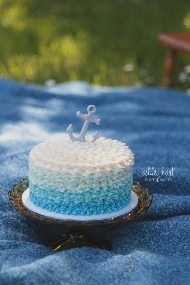 Nautical inspired Smash cake for a photo session with Ashley Hart Photography.  Buttercream waves and fondant anchor on top.
