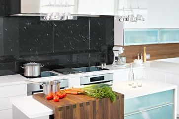All mill-work designed, provided and installed by Yorkville Design Centre Featuring the custom L shaped butcher block that slides along the island on a s/s rail.