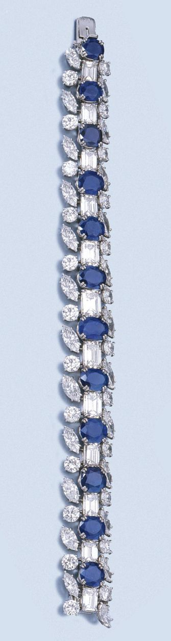 FINE SAPPHIRE AND DIAMOND BRACELET, HARRY WINSTON, 1960S. mmer Price with Buyer's Premium) The articulated band designed as a series of oval, circular-cut and cushion-shaped sapphires alternating with step-cut diamonds, the three larger ones weighing respectively 1.44, 1.61 and 1.81 carats, the borders set with marquise-shaped and brilliant-cut diamonds, mounted in platinum, length approximately 175mm, unsigned, maker's marks.