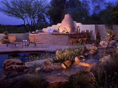 Southwestern Pool Area With Stone Outdoor Kitchen