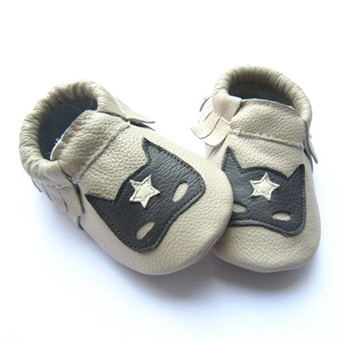 Masked Defender, Baby Shoes Sizes 11cm to 14cm Is it a bird, is it a plane no its super baby... a light grey shoe with a dark grey mask that has a white star for detail, perfect for a wee adventure. Softies Moccasins are soft sole elasticated leather baby shoes designed for babies, crawlers, cruisers and first walkers. They're great for protecting little toes when crawling on rough surfaces, please note this design has a leather base not suede. They are soft sole baby shoes made from the…