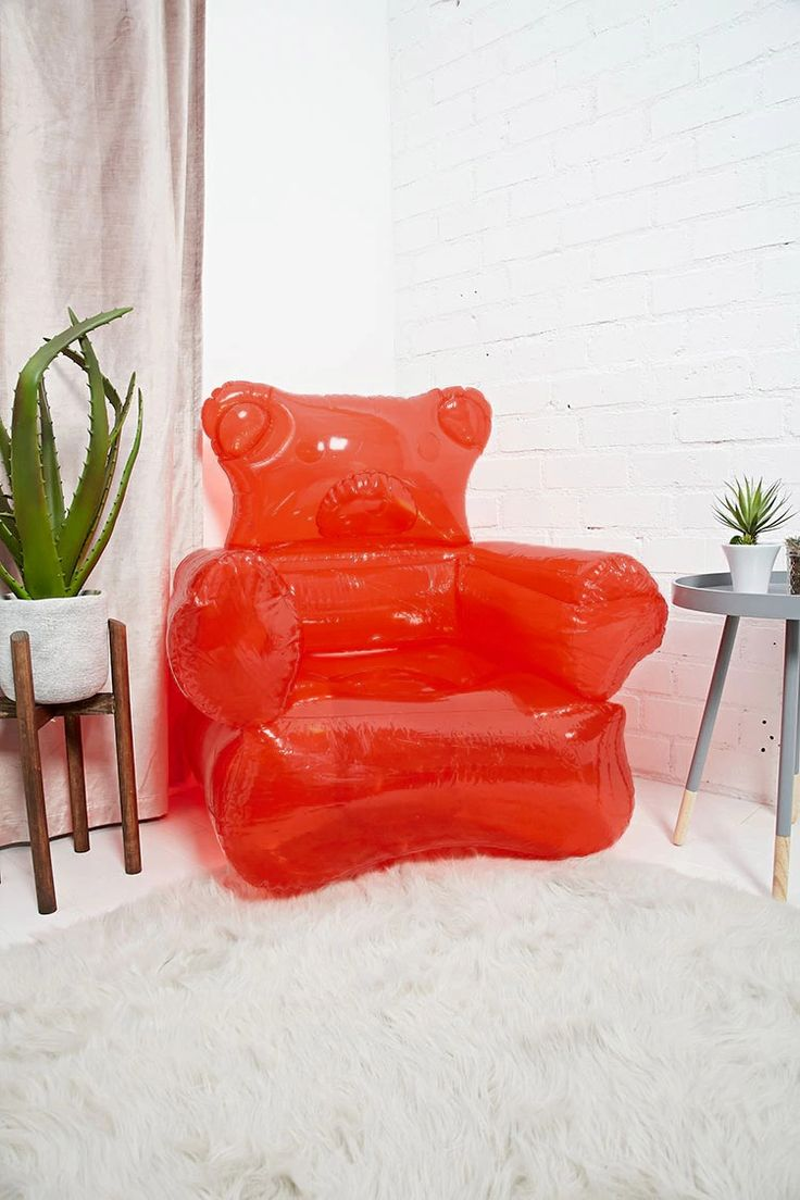 An inflatable chair featuring a bear-shaped design including a foot pump.