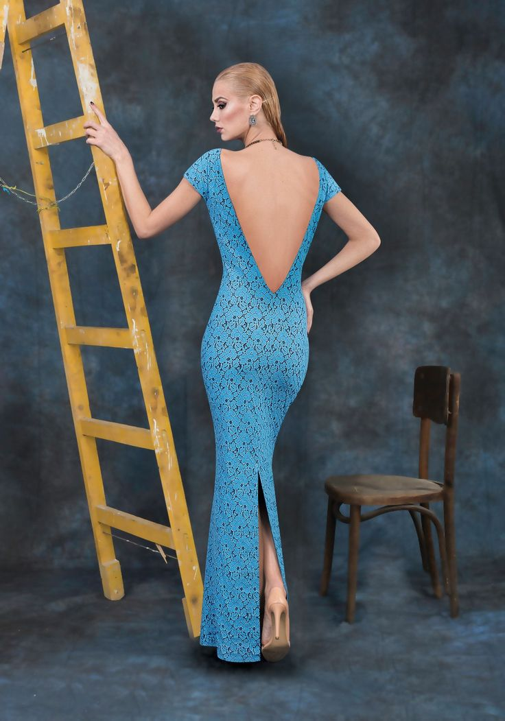 Long, blue, elegant dress made of lace with a deep cleavage in the back.
