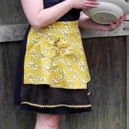 Betty Draper Inspired Hostess Apron. You can look just like Betty Draper from Mad Men with this free sewing apron pattern! It's simple to create and helps you achieve that retro look while still being totally useable. Use this free sewing apron pattern to make a fun sewing project you'll love.  #MadMen #sewing