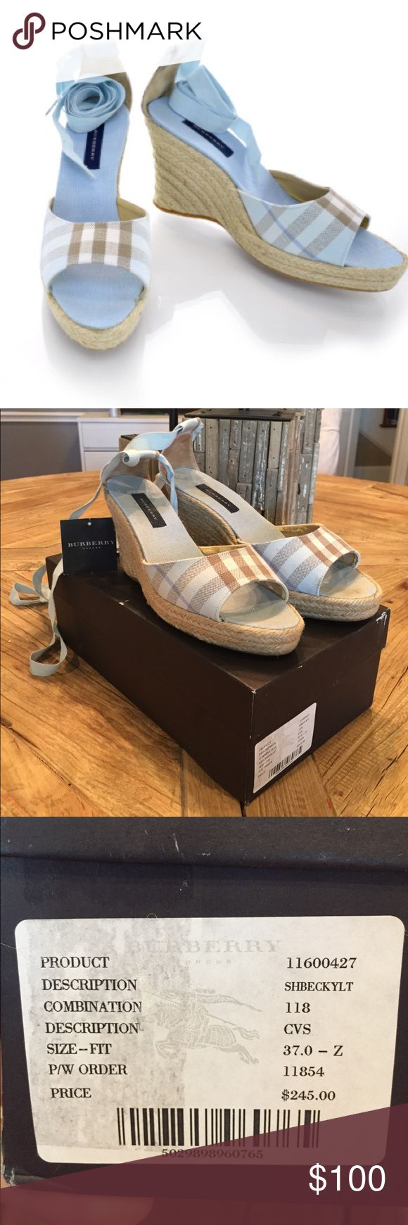 Authentic Burberry size 37 nova check wedge These are authentic Burberry size 37 nova check wedge. These chic espadrilles have a one inch platform and a three inch wedge. These have open straps of nova check canvas in blue with an ankle strap. These are marvelous espadrilles, with a distinctive look, from Burberry.  They are in great condition on the outside but the inside has peeling. I took a picture of the peeling. It isn't noticeable while wearing them.  Retail $245. Box included…