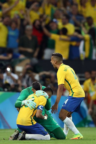 Neymar of Brazil celebrates with goalkeeper Weverton after scoring the winning…