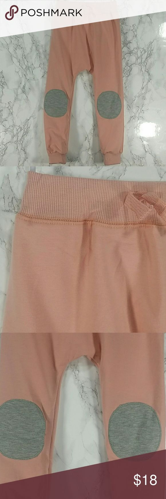 Light pink patches sweatpants. Kids Adorable and comfortable light pink sweatpants with knee patches.  Pull up style.  This item is brand new and never used.  #11608 Bottoms Sweatpants & Joggers