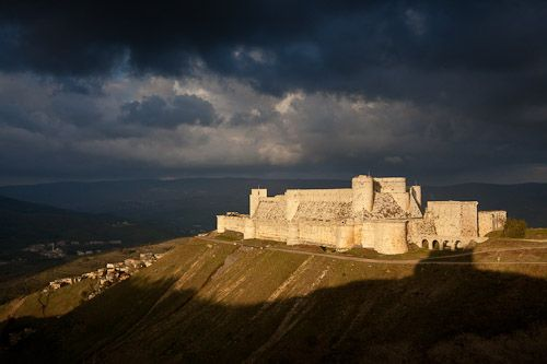 Krak des Chevaliers, Syria. A beacon of light shining forth from amidst the stormy clouds.